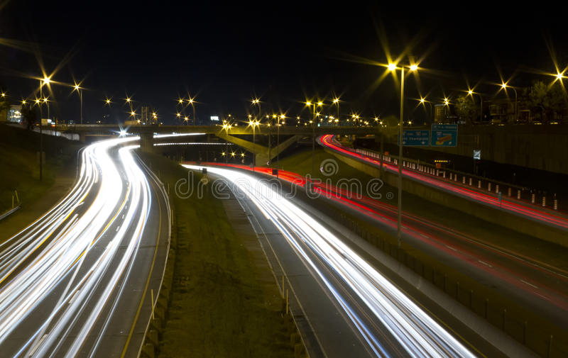 Light speed. Light trails of moving vehicle at night