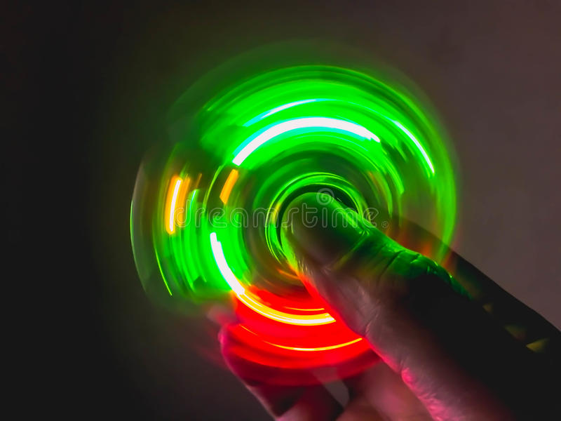 Download Light spinning on hand stock image. Image of light, relaxation - 99235607