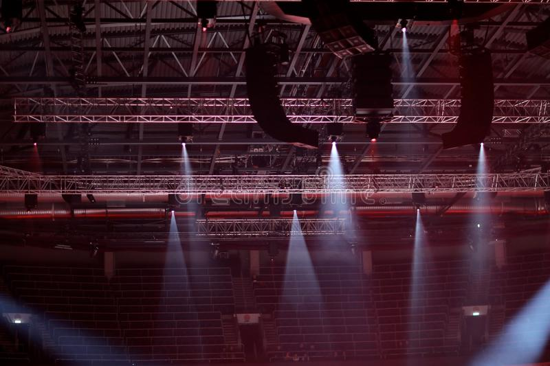 Light spotlights mounted on consoles. Under the roof of a sports facility stock photos