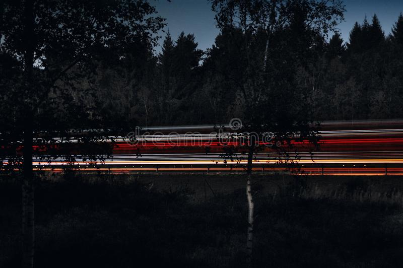 Light streaks on highway at night stock image