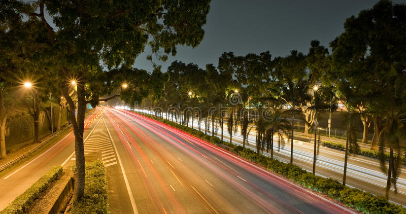 Light streaks at night. On a highway in singapore stock photos