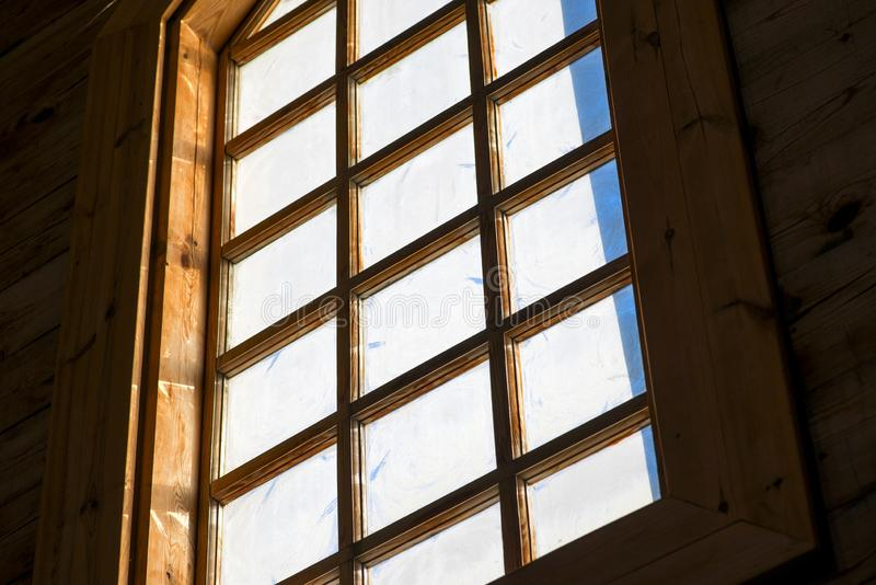 Light Stream through Window. Shafts of light stream through stained glass window inside a church royalty free stock photo