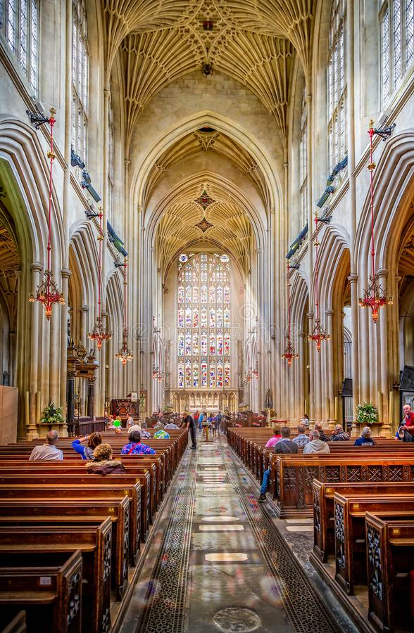 Light streaming through stained glass windows in Bath Abbey, Somerset,UK stock image