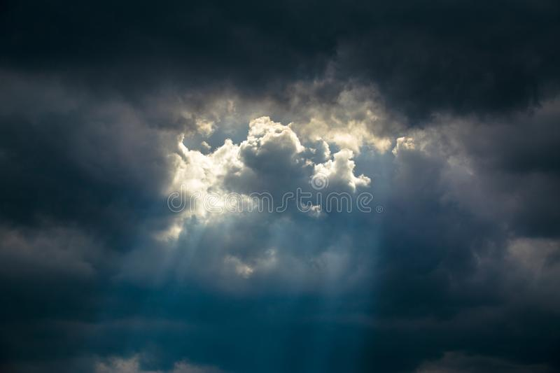 Light of sun from dark clouds. royalty free stock photography