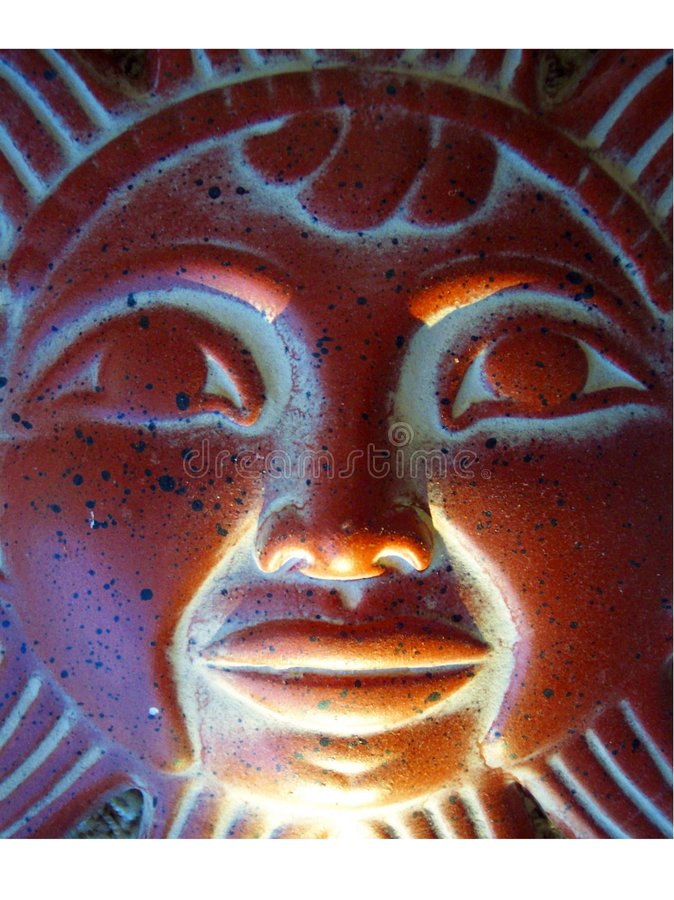 Light on the Sun God. Light coming in on the Mezo-American sun god stock images