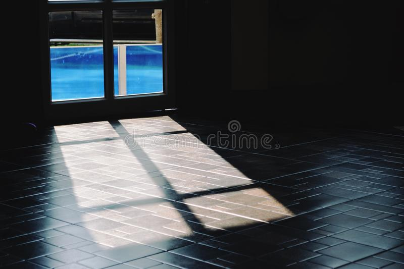 The Light That Survived Through The Glass Door Cause Shadow On The
