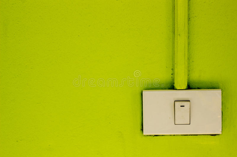 Light switches on the green wall. Switches for lighting on the green wall royalty free stock photos