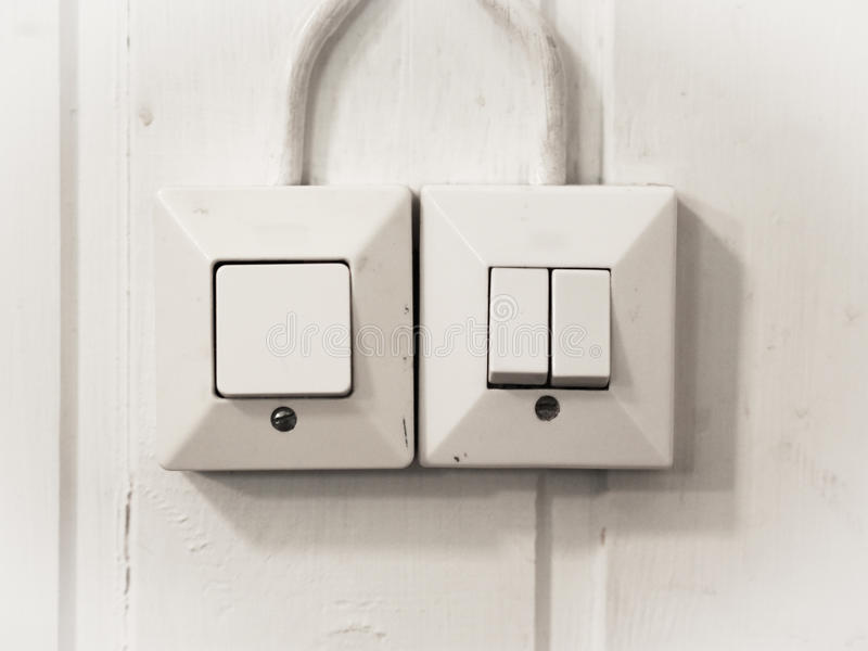 Light Switches. On a White Wall stock photo