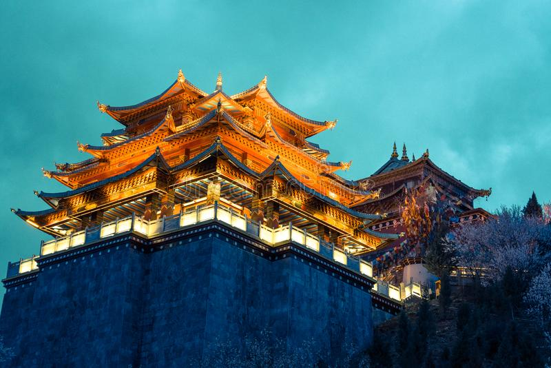 Light from the temple at night in vintage and dramatic tone at Shangri-la,. China stock photos