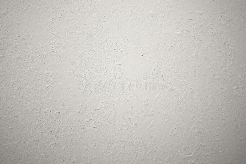 Light textured plaster on the wall is different. The texture on the wall is rough without seams decor royalty free stock photo