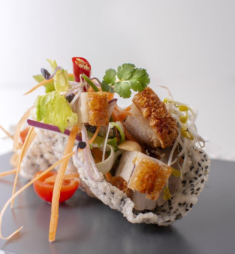 Light thai  salad bowl with fresh herbs and roast pork stock photos