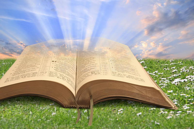 Light to the world. Conceptual photo of open bible depicting spiritual light to the world stock photography