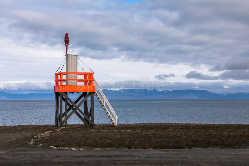 Light tower at the beach near longyearbyen, spitsbergen, svalbard archipelago, norway royalty free stock photos