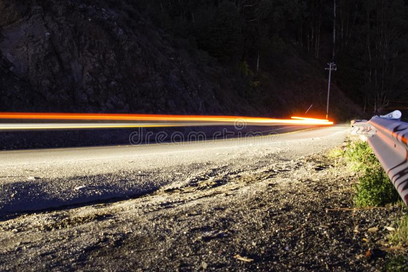 Light tracers of a car on a highway. At night royalty free stock photos