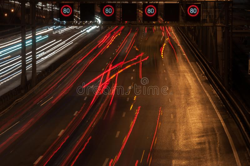 Light traces of passing cars. City highway. City street. A traffic jam stock photo