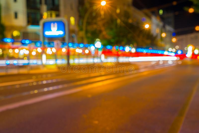 Light trails along busy European city street stock image
