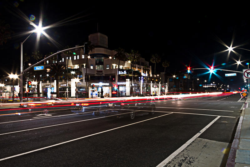 Light trails of busy traffic on Pacific Coast Highway & Main Street in Downtown Huntington Beach, CA stock photos