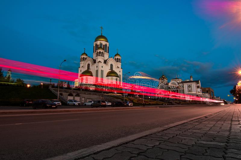 Light trails on the city street after sunset. Church of All Saints, Yekaterinburg, Russia. Temple on the Blood. royalty free stock image