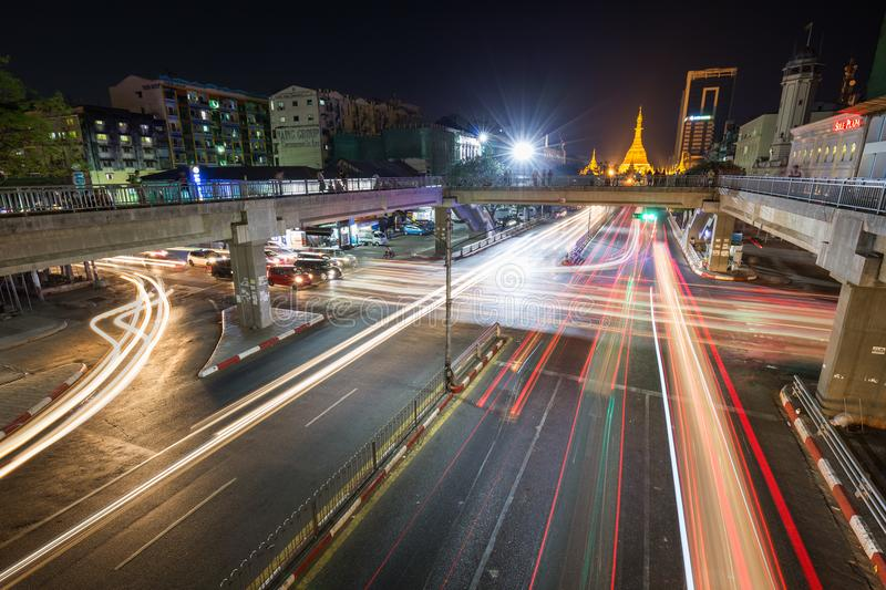 Light trails at the downtown in Yangon at night. Traffic`s light trails and intersection of the Anawrahta and Sule Pagoda Roads at the downtown in Yangon Rangoon stock images