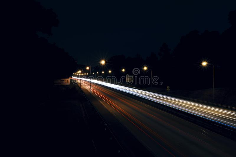 Light trails on the highway stock photography