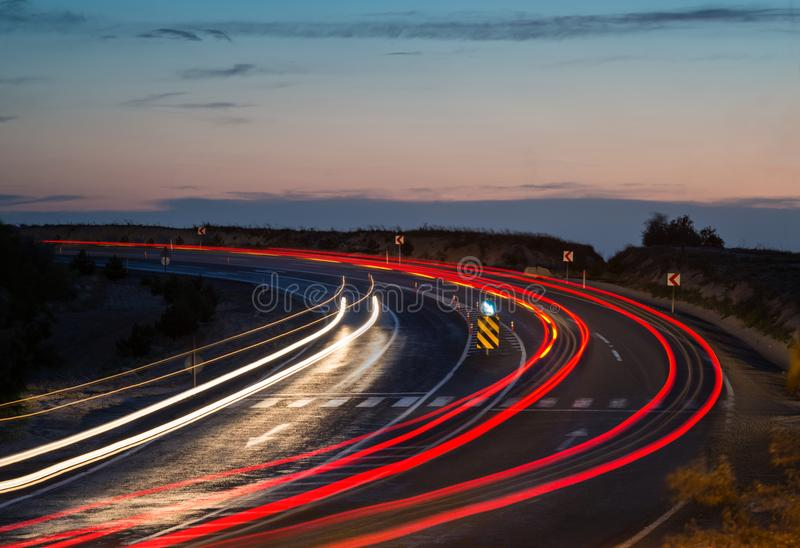 Light trails on highway curve. At night royalty free stock photography