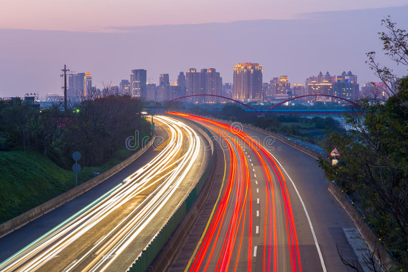 Light trails of highway in Hsinchu,Taiwan. Skyline of chubei city, hsinchu, taiwan royalty free stock image