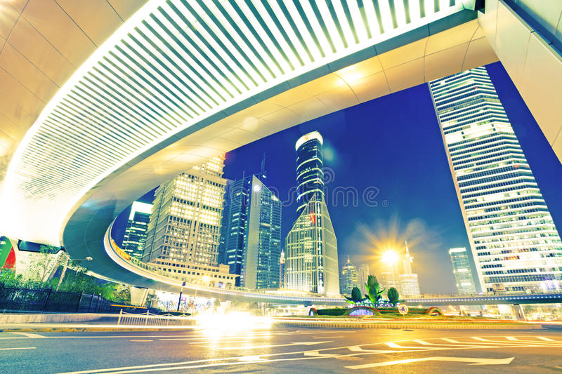 The light trails on the modern building background stock photography