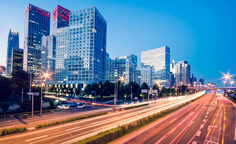Light trails on the modern city at dusk. In beijing,China royalty free stock photo