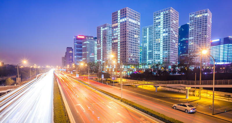 Light trails on the modern city at dusk in beijing stock photo