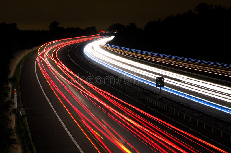 Light trails on a motorway at night stock images