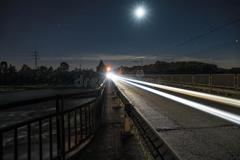 Light trails on the road. In the night stock photography