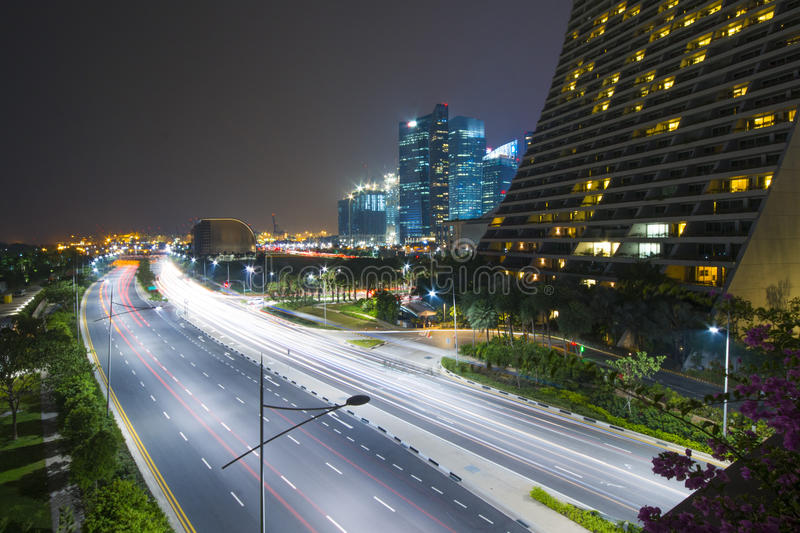 Light trails on the road in Singapore. Night royalty free stock photos