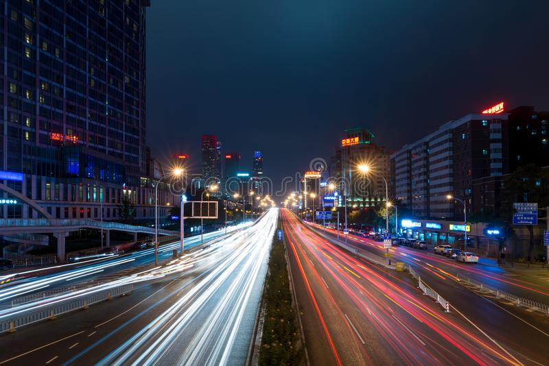 Light trails on the street at Beijing Central Business district royalty free stock image