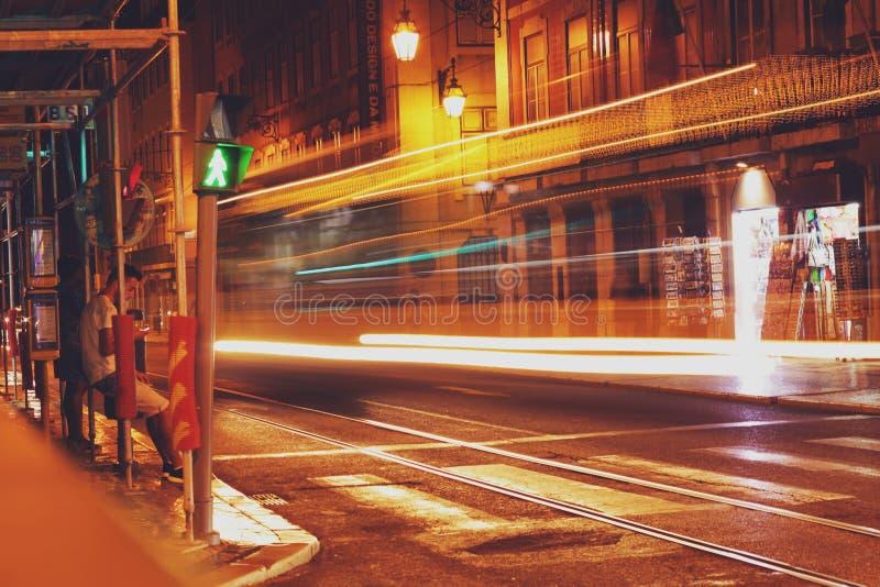 Light trails on street stock photos