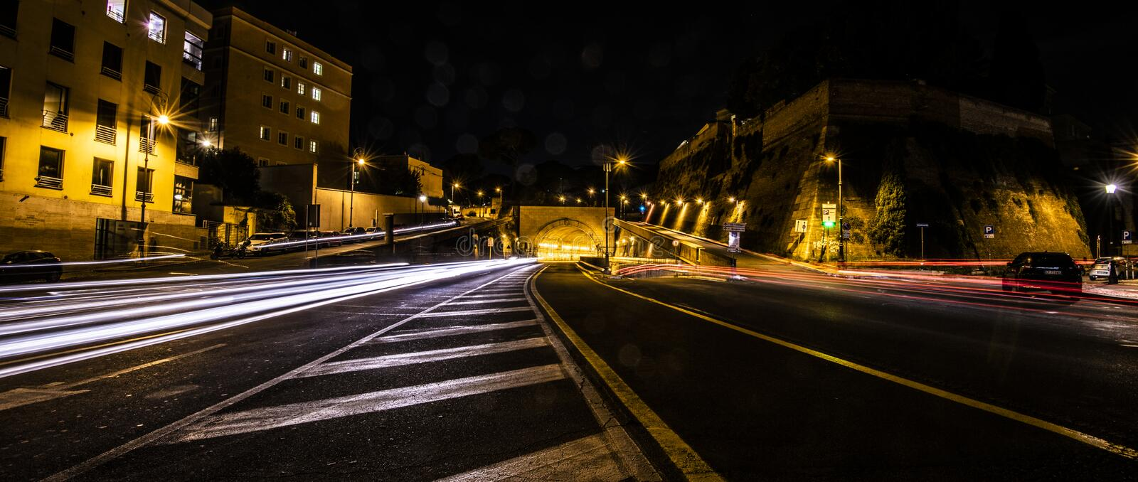 Light trails on street in Rome royalty free stock images
