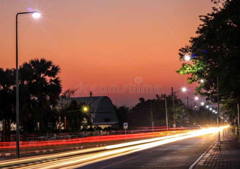 Light trails on sun set stock photos