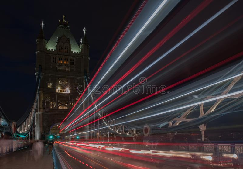 Light trails on Tower bridge at night, London, England royalty free stock photo