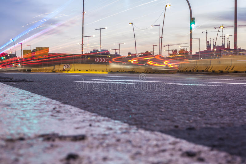 Light tralight trails through a road construction site royalty free stock photos