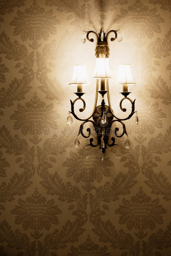 Light on the wallpaper. Stylish lamp on the wallpaper royalty free stock photo