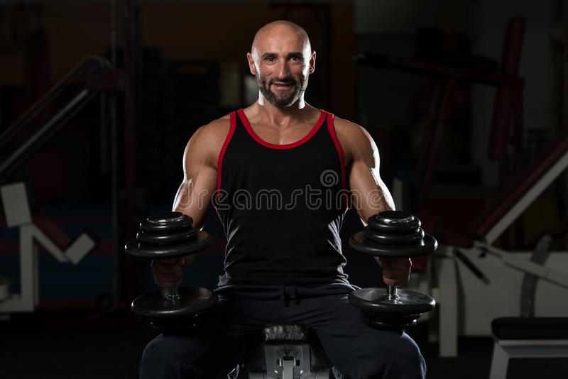 Light Weight Baby. Portrait Of A Physically Fit Mature Man In A Healthy Club stock photography