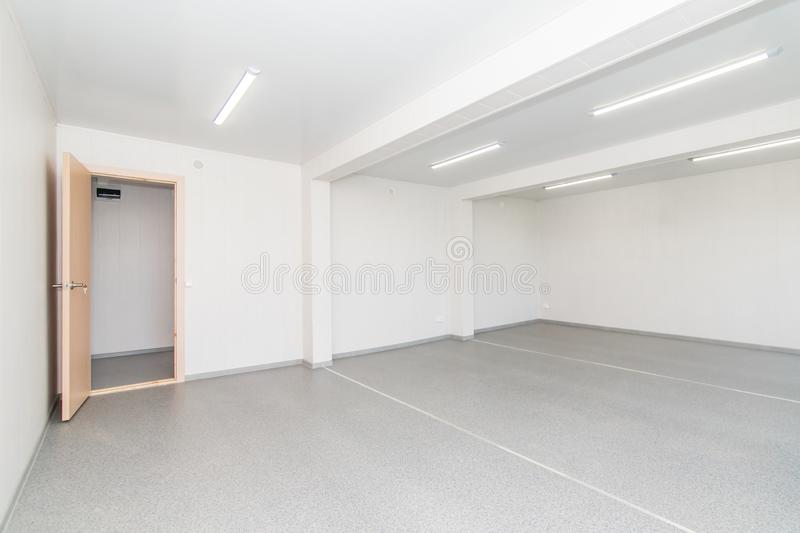 Light white empty office room with bright lighting royalty free stock photography