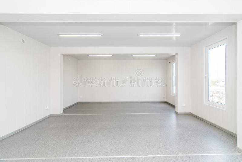 Light white empty office room with bright lighting royalty free stock images