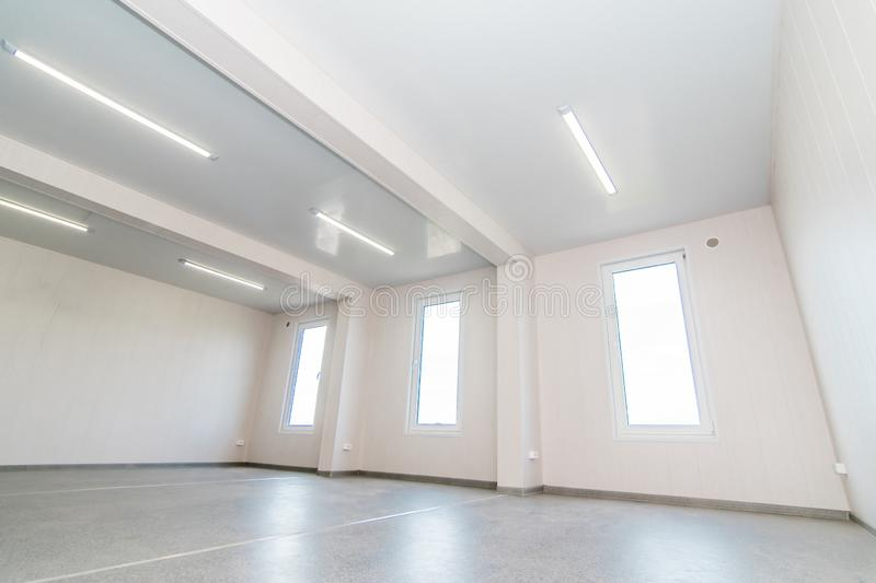 Light white empty office room with bright lighting stock images