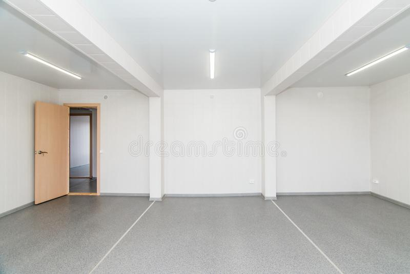 Light white empty office room with bright lighting royalty free stock photo