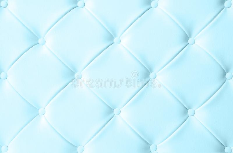 Light white luxury upholstery sofa texture background concept for clean gray vintage leather furniture pattern wallpaper, closeup. Interior elegant armchair stock image