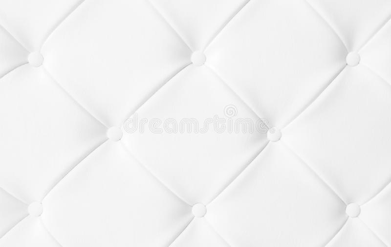Light white luxury upholstery sofa texture background concept for clean gray vintage leather furniture pattern wallpaper, closeup. Interior elegant armchair royalty free stock photography