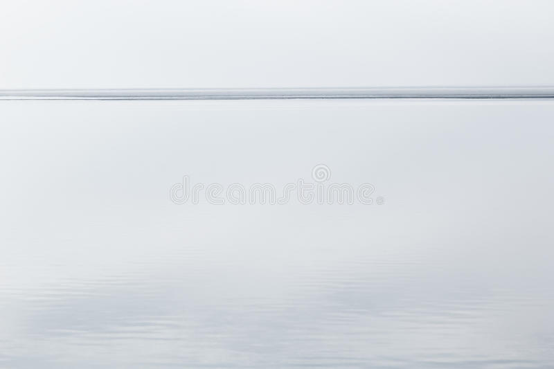Light white minimalist landscape with a horizon line. Copy space. Background royalty free stock image