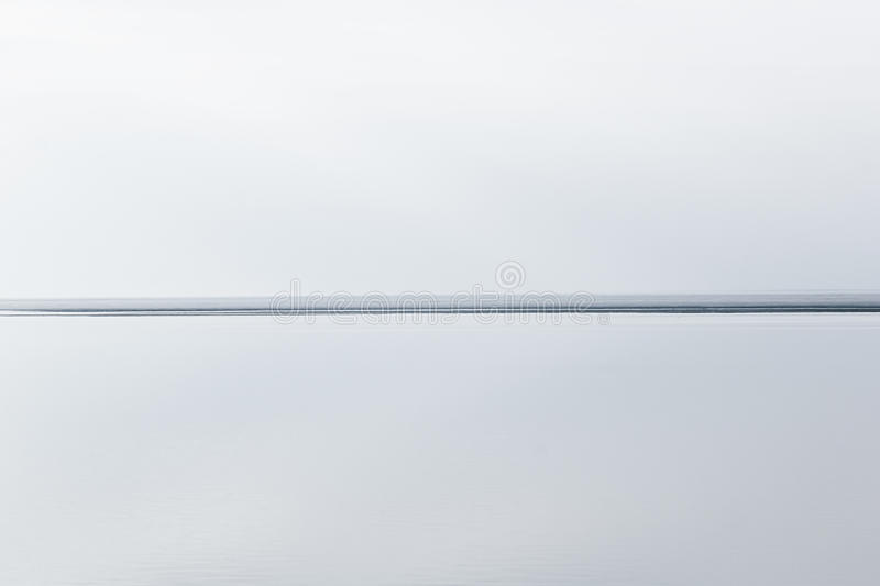 Light white minimalist landscape with a horizon line. Copy space. Background royalty free stock photography