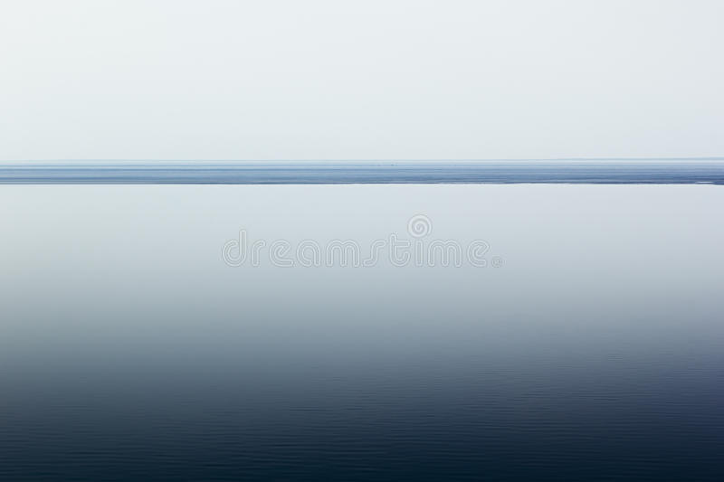Light white minimalist landscape with a horizon line. Copy space. Gradient. Background royalty free stock photo