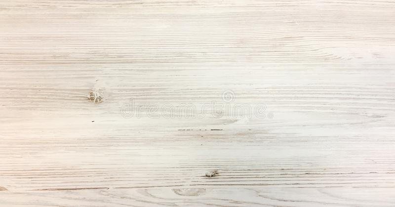 Light white wash soft wood texture surface as background. Grunge whitewashed wooden planks table pattern top view. royalty free stock images